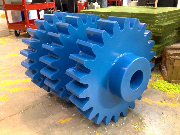MC901 Blue machining Grade Nylon gears, note the Green Oil Filled Nylon in the background ready for machining